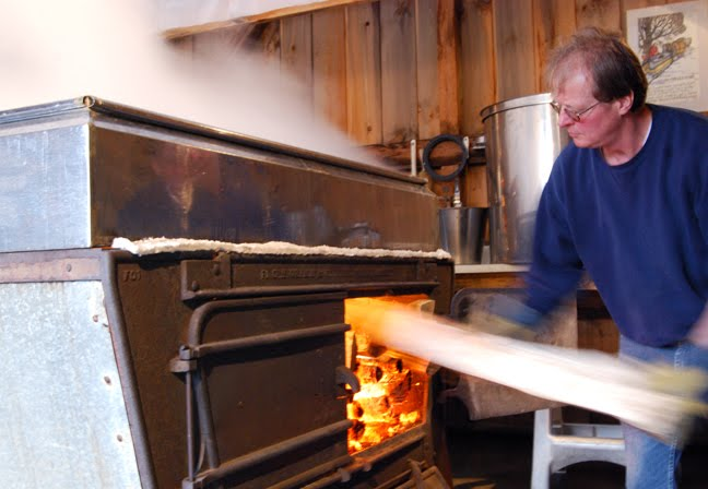 Doug Bragg works in his sugarhouse in East Montpelier.